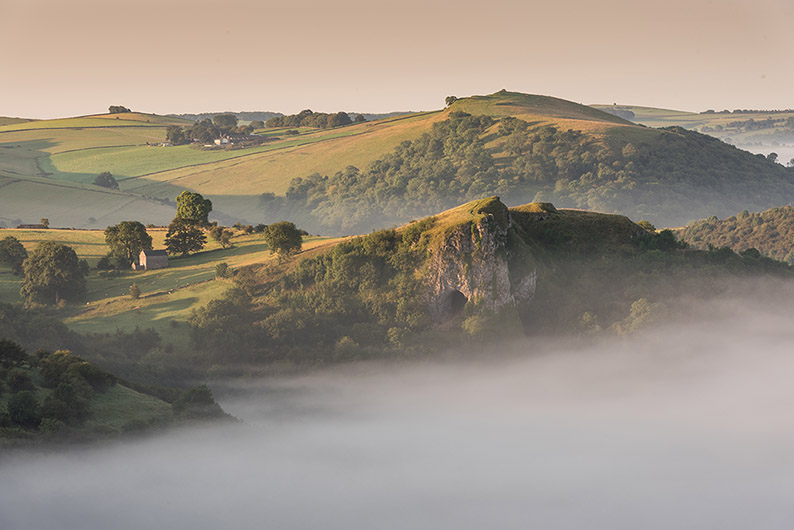 Thors Cave Misty Sunrise by Jason Bould