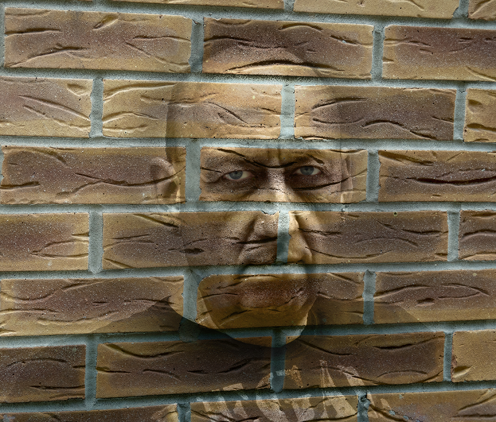 Man in my wall by Claire Wade